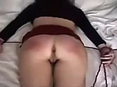 My wife lies on the bed with her hands bound ready for hardcore sex