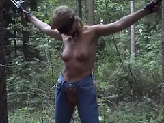 Mature blonde gets some tits flogging in the woods