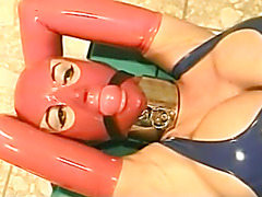 Extremely busty babe in latex gets tortured