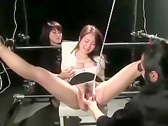 Master torments two Asian chicks in BDSM room
