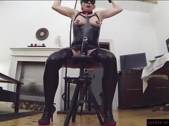Horny MILF in latex used huge black dildo